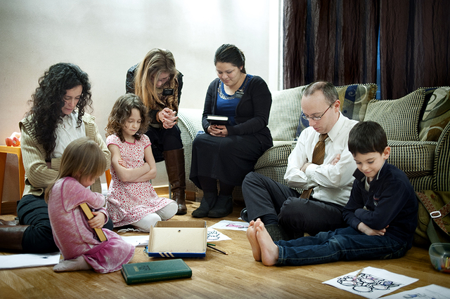 Family Praying Featured on National Geographic