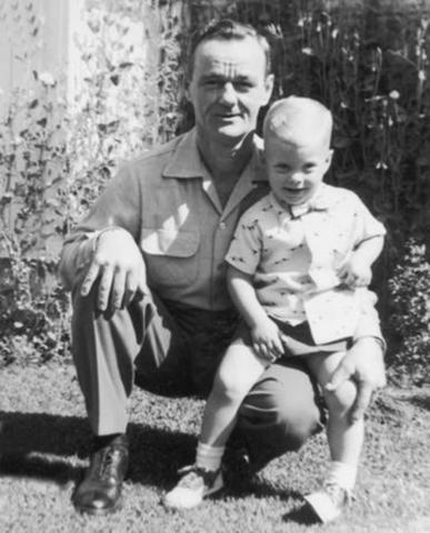 Elder David A. Bednar as a child with his father