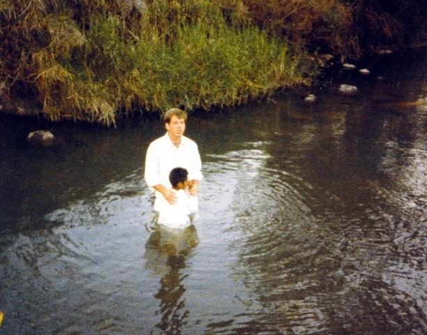 Dusty baptizing someone on his mission