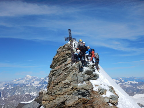 Nile Sorenson stands on top of the Matterhorn with friends.
