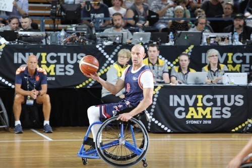 Retired Air Force Tech. Sgt. Joshua D. Smith plays with Team USA in a wheelchair basketball game at the 2018 Invictus Games in Australia in October.