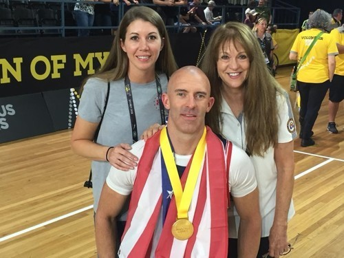 Retired Air Force Tech. Sgt. Joshua D. Smith with his wife, Michelle, left, and mother Becky Smith, right, at the 2018 Invictus Games in Australia in October.