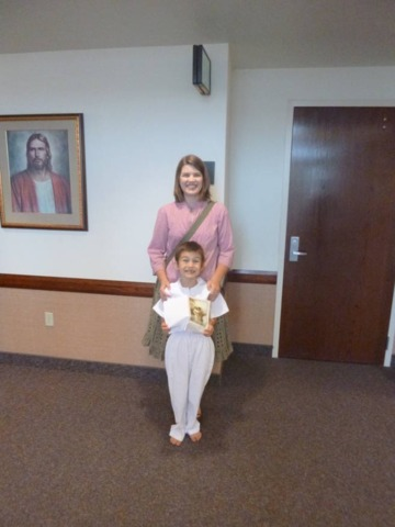 Spencer Evans with his mom Katie Evans on his baptismal day.