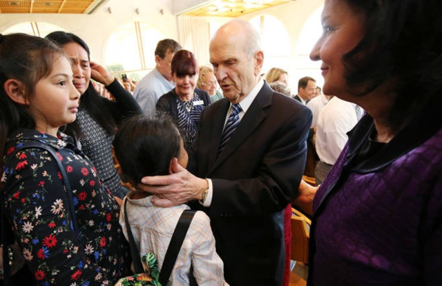 President Russell M. Nelson speaks with Ella Bautista after the Jerusalem District Conference at the BYU Jerusalem Center on Saturday, April 14, 2018.