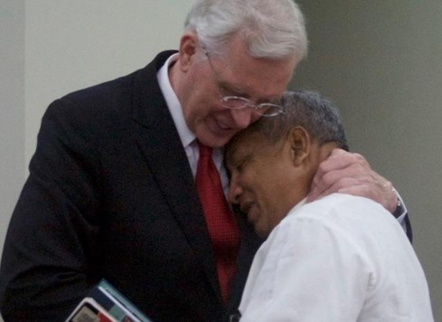 Elder Christofferson hugging a church member