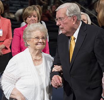 Elder and Sister Ballard walking together