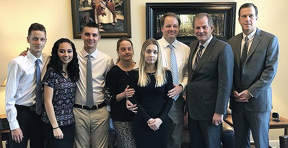 Elder Stevenson with the Petty family, who lost their daughter and sister in the Parkland shooting.