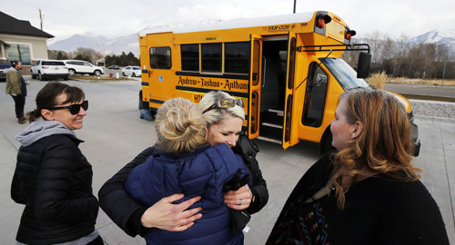Anne Teerlink, facing camera, hugs Sharon Honey in Pleasant Grove on Monday, Dec. 24, 2018.