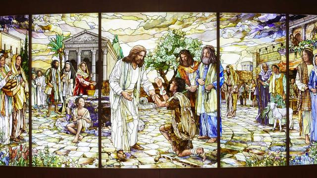 A stained-glass New Testament story of Jesus Christ ministering to those in need. The glass is located in the Rome Italy Temple Visitors' Center.