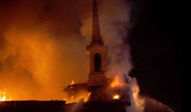 The St. George East stake center in flames.