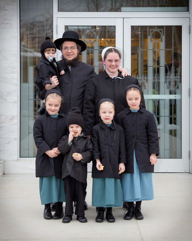 The Weaver family outside a temple of The Church of Jesus Christ of Latter-day Saints.
