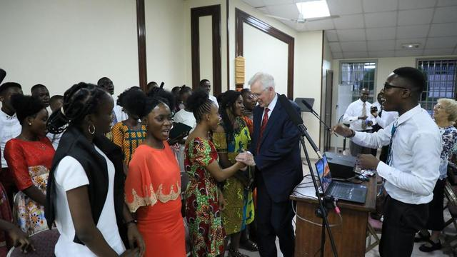 Elder D. Todd Christofferson of the Quorum of the Twelve Apostles greets members of the youth choir at the conclusion of a youth meeting in Abidjan.