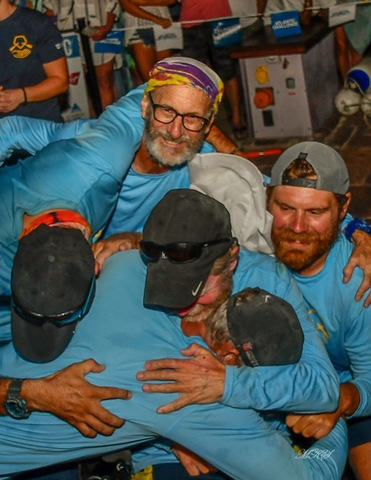 The Row4ALS team hugging after they finished the Atlantic Challenge