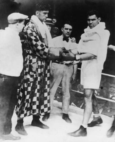 American world heavyweight champion boxer Jack Dempsey (1895-1983) with Argentine heavyweight champion Luis Angel Firpo (left) before their match at the Polo Grounds in New York, September 14, 1923. Dempsey won with a knockout after a bout lasting only 3 minutes and 57 seconds. (Photo by Hulton Archive/Getty Images)