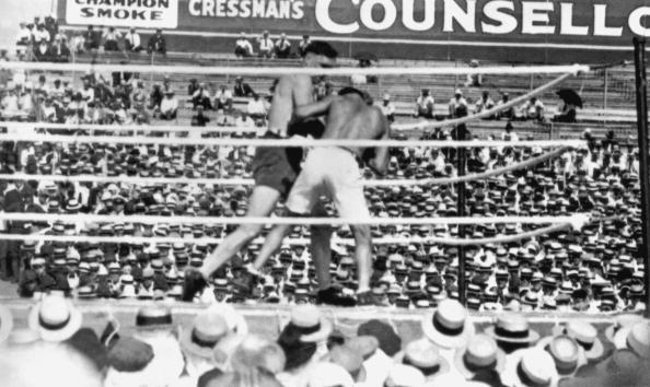 Jess Willard (left) in action against Jack Dempsey during their world heavyweight title fight at Toledo, Ohio, on July 4, 1919. Dempsey won the fight at the end of the third round and he held onto the title until 1926. (Photo by Topical Press Agency/Getty Images)