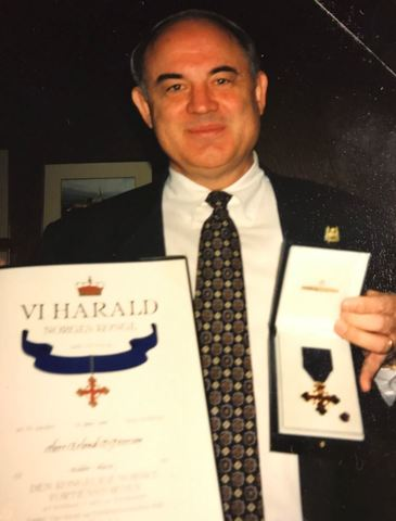 Erlend Peterson with his knighting diploma and pin