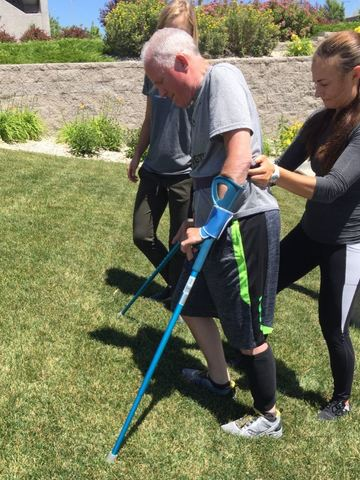 President Bingham walking with the help of crutches