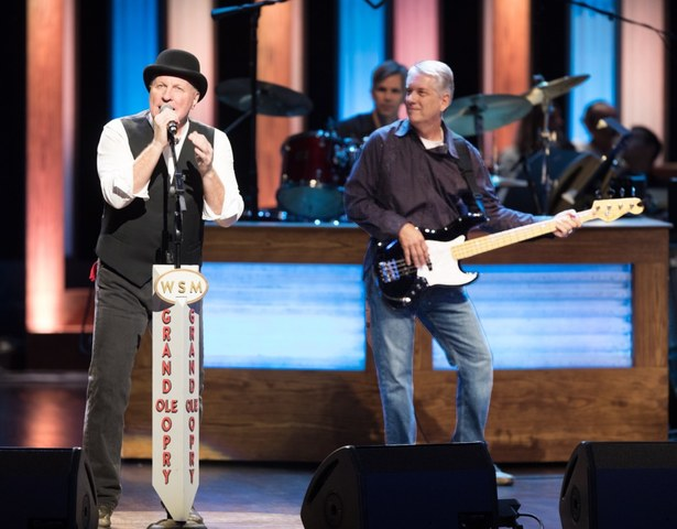 Collin Raye and Kevin Guest performing for the Grand Ole Opry.