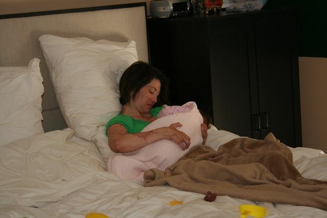 Carol holding baby Safiya
