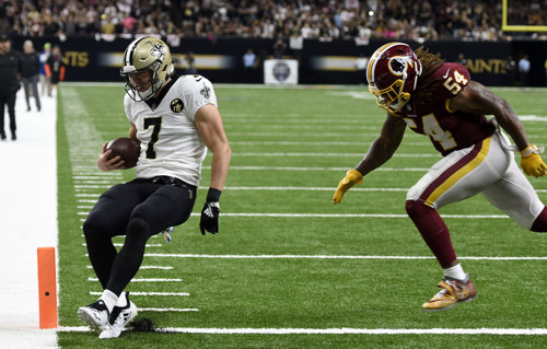 New Orleans Saints quarterback Taysom Hill (7) scores a touchdown in front  of Washington Redskins linebacker Mason Foster (54) in the second half of  an NFL ... 2259870f7