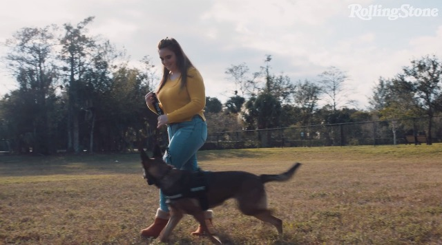 Parkland shooting survivor and Latter-day Saint teen Maddy Wilford plays with her service dog